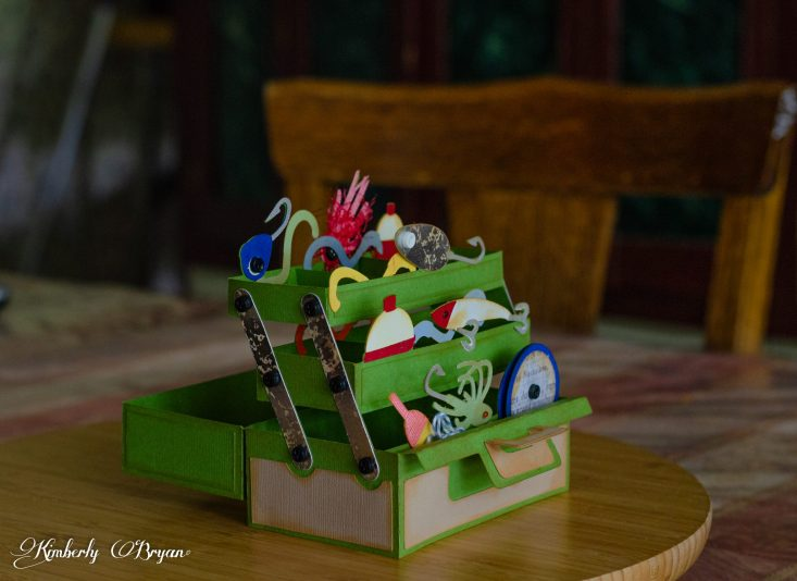 You are looking at the Tackle box 3d Box card completed from the side. I sure does look like a tackle box full of lures, worms, and other bait. I used lots of fun bright cardstock to really bring it to life.