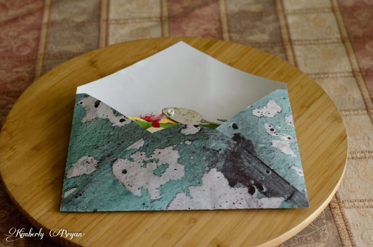 You are looking at the envelope I cut out with my Silhouette Cameo 3. The envelope with the tackle box card svg file. I used designer paper in teal to go with the box card.