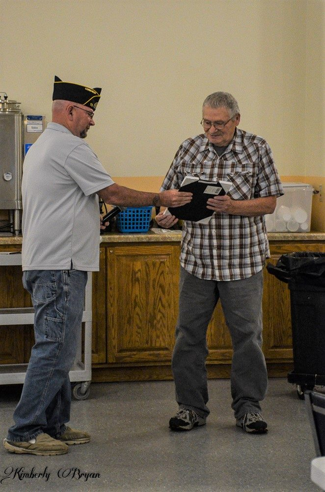 You are looking at a photo of my dad receiving a plaque for his service to the US Amy.