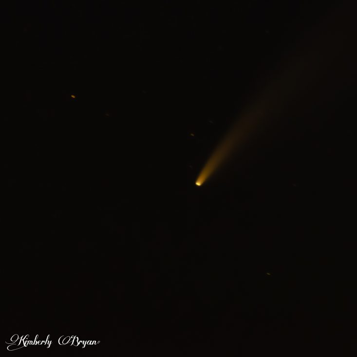 You are looking at the comet NEOWISE in the night sky. That comet was an amazing sight. It was green, gold with a very long golden tail of ice and rock. I took this photo with a Tamron 150-600mm lens..