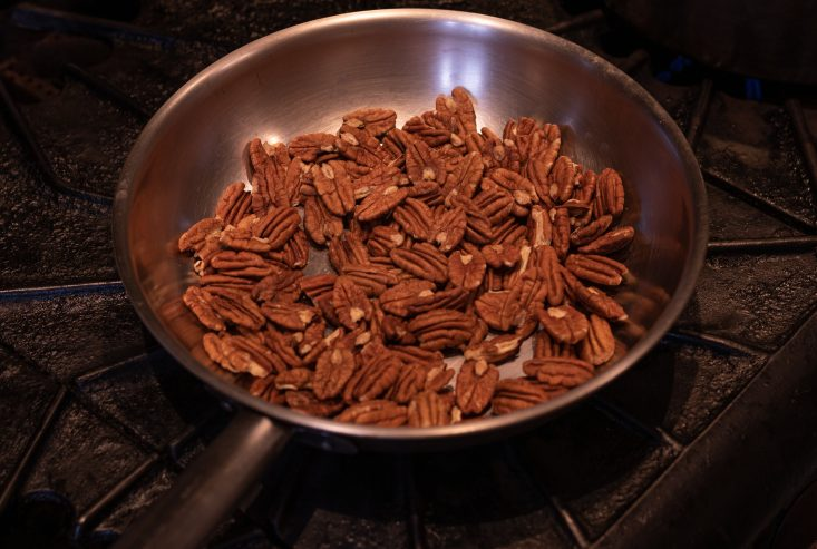 You are looking at pecans in a dry stainless steel skillet, toasting on medium heat. This is from my recipe, Toasted pecans made with real maple syrup.