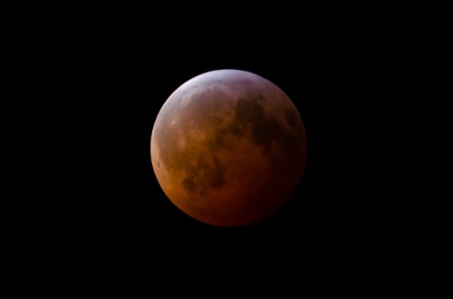 You are looking at May's Super Blood Moon and Lunar Eclipse. It's a beautiful orange ball with the earth's shadow beginning to cover the Super Moon.
