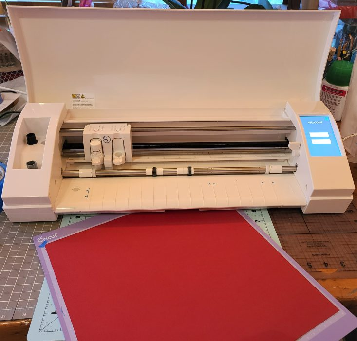 You are looking at my Silhouette Cameo 3, electric die cutting machine. I'm cutting out the red paper for the Side if Fries 3D Pop-Up Box Card.
