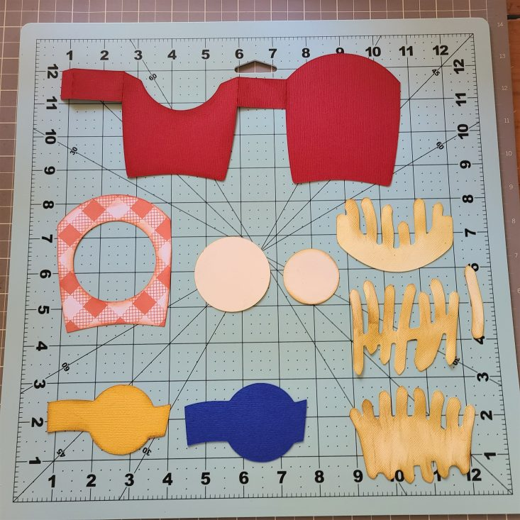You are looking at the cut out pieces. Of the Side of Fries 3D Box Card. I have gone around the edges of the fries and box pieces with and ink pad. This helps with giving the card more detail.