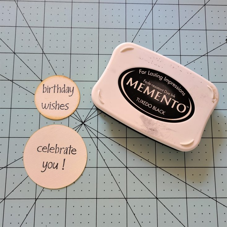 """You are looking at the sentiment labels that I stamped in black. One say's """"birthday wishes"""". The other say's """"celebrate you"""". The birthday wishes will go on the front of the Side Of Fries 3D Box Card. The celebrate you, will go on the back of the card."""