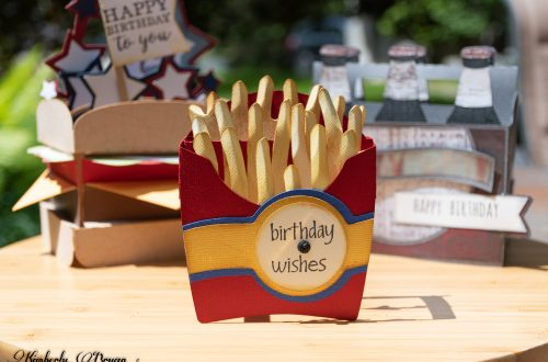 """You are looking at the Side of Fries 3D Pop-Up Box Card I made for a birthday card. This card is very colorful and is a lot of fun. It actually looks like a box of french fries that you would get from a fast food restaurant! For the box base I used red paper, with a blue layer going across the front of it. With a yellow layer on top of that. I also stamped """"birthday wishes"""" in a label. That sits on top of the yellow layer. The french fries inside the box are a light yellow color. That I inked around with a light brown ink. The fries are also 3D that stand upright in the fry box."""